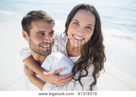 happy couple having fun at the beach