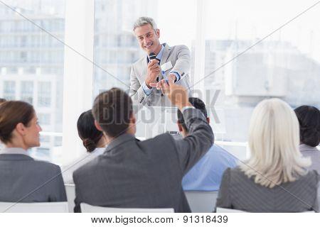 Businessman doing speech during meeting in office