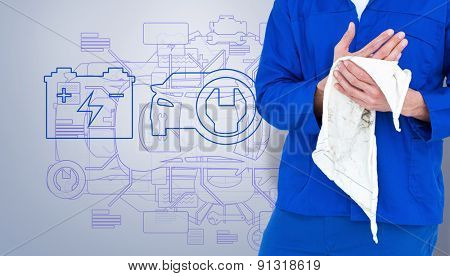 Cropped image of mechanic wiping hand with napkin against grey vignette