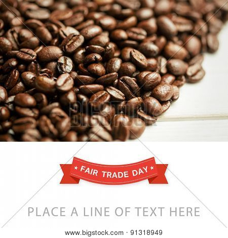 Fair Trade graphic against coffee beans