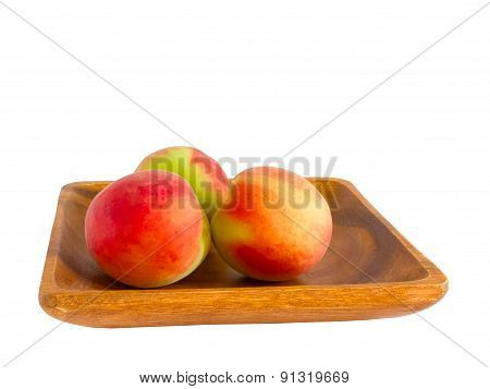 Peaches On Wooden Plate.