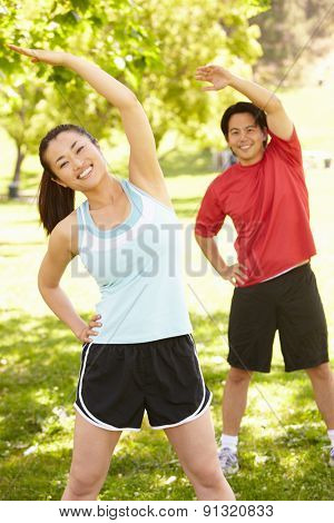 Asian couple exercising