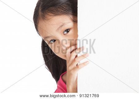 Little Asian Girl Peeking Behind A White Board