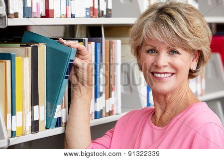 Mature student in library