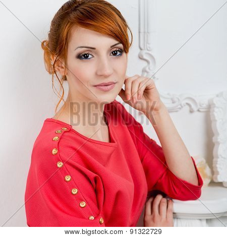 Young Fashionable Woman Posing In Red Dress