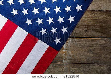 Close-up Of American Flag On Wood Background