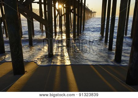 Fishing Pier Pillars and Sunburst at Sunrise