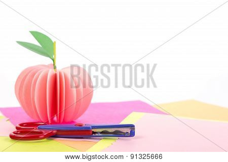 Example crafts out of paper - apple on color background