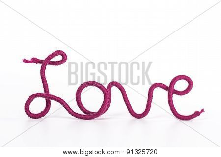 word love of red thread on white background