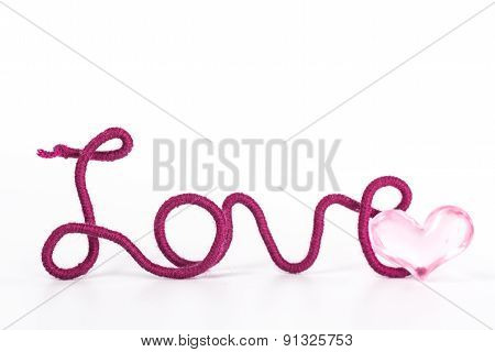 isolated word love of red thread and pink heart