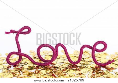isolated word love of red thread on golden heart background