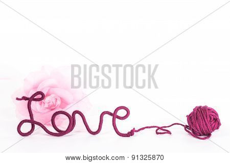 isolated word love of red thread and fabric flower