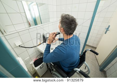 Disabled Man Trimming Beard