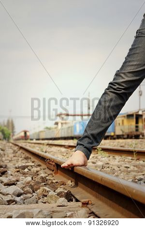 Women Wearing Jeans Standing At Train Station.