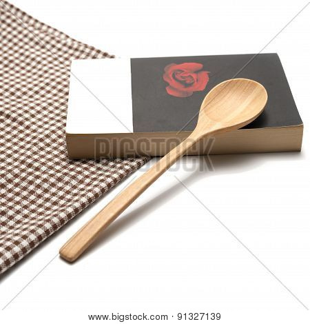 Book And Spoon With Kitchen Towel