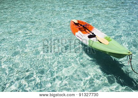 Colorful Plastic Canoe On Water Sandy Beach. Coast Of Andaman Sea, Thailand;