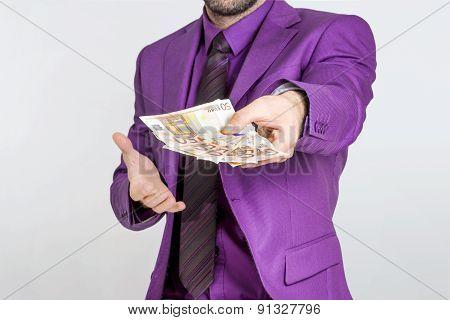 Businessman showing cash