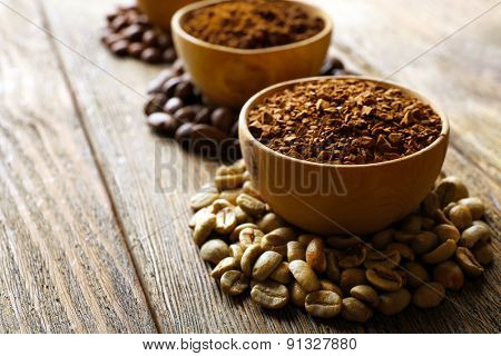 Various of coffee in small dishes on wooden background