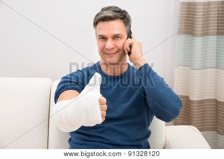 Man With Fractured Hand Showing Thumb-up