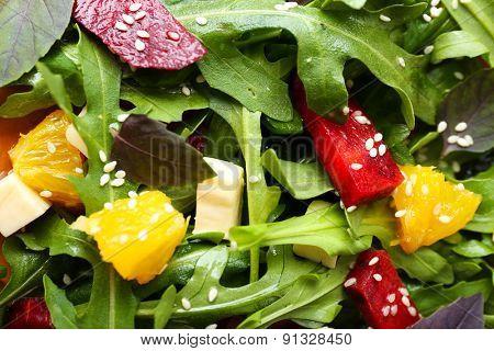 Tasty salad with arugula leaves, closeup