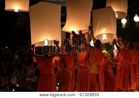 Thai monk with light lantern