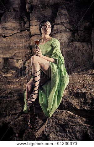 Beautiful Elf Princess Is Drinking A Wine On The Rock.