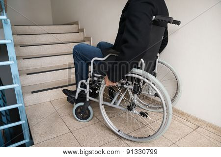Man On Wheelchair In Front Of Staircase