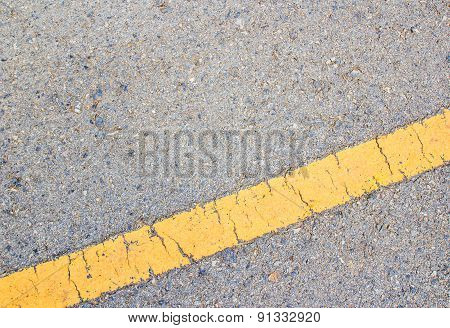 Road Asphalt Texture And Yellow Line
