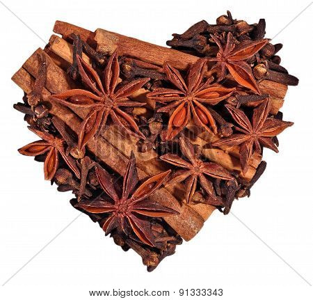Star Anise, Cinnamon Sticks And Cloves In The Form Of Heart On A White
