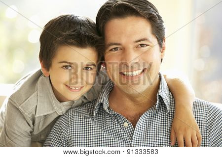 Portrait Of Hispanic Father And Son At Home