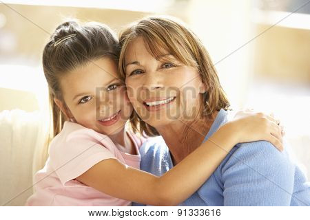 Hispanic Grandmother And Granddaughter Relaxing At Home