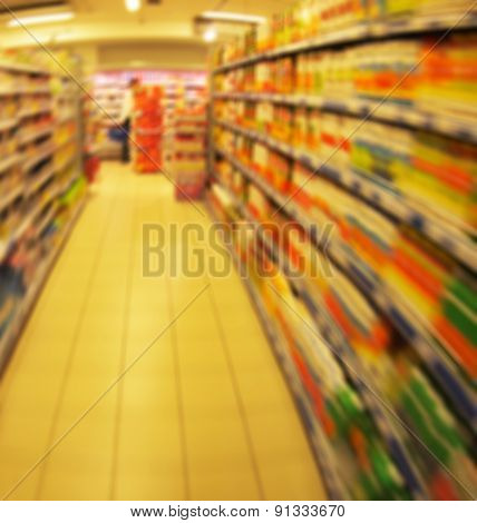 Defocused Long Shelves Of Children's Goods And Products