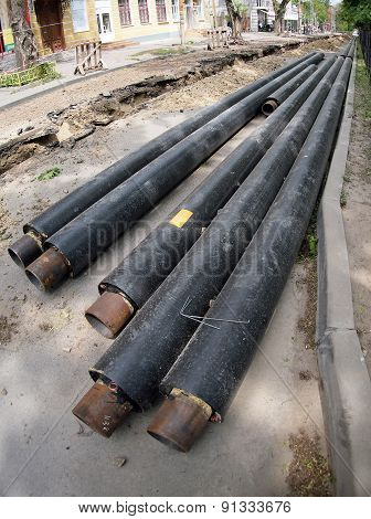 Trench In The Streets Of The City And New Pipes For Pipeline Repair