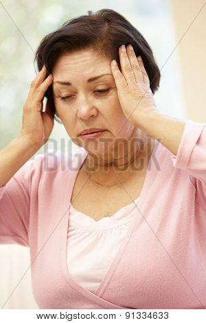 Senior Hispanic woman with headache
