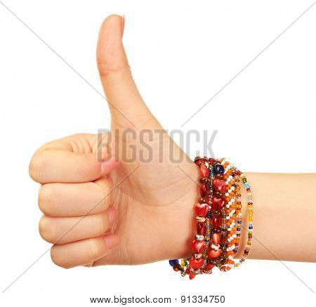 Female hand with bracelets isolated on white