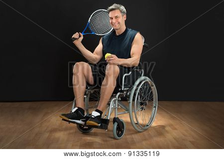 Disabled Man Holding Racket And Ball