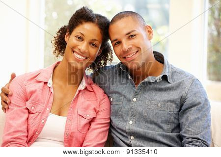 Mixed race couple at home