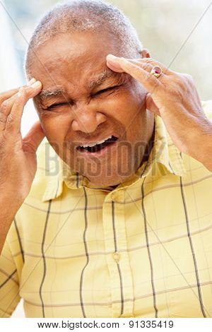 Senior African American man with headache