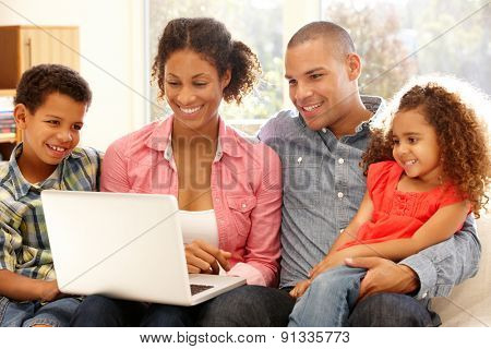 Family working on laptop at home