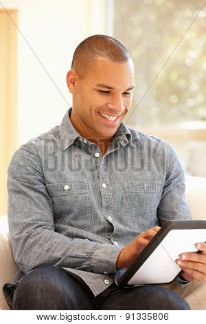 Man working on tablet at home