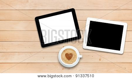 Two Tablet Pcs And Coffee On A Wooden Table