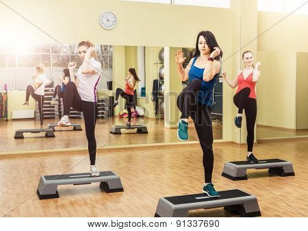 Group Of Women Making Step Aerobics