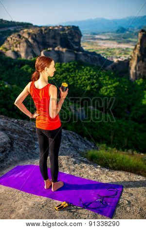 Sport woman in the mountains