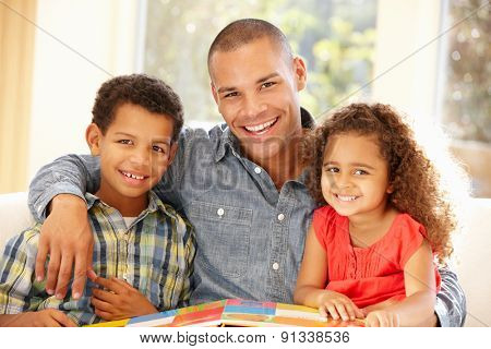 Father reading to children
