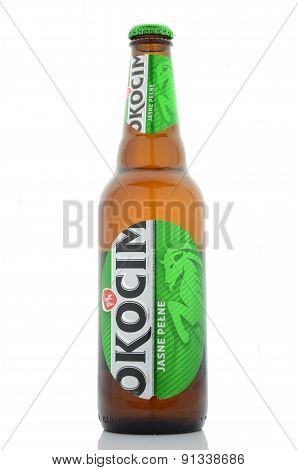 Okocim full light beer isolated on white background.