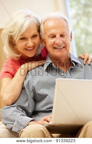 Senior man and daughter using laptop