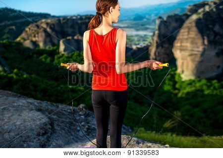 Woman having exercise in the mountains