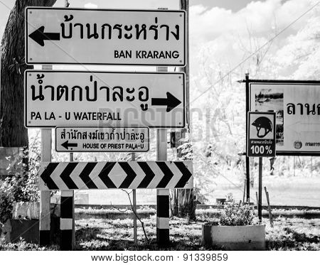 BW Infrared road sign indicating distance Thailand