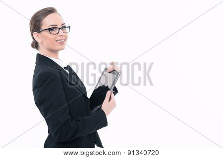 Beautiful woman with tablet in formal clothes