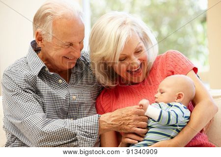 Senior couple with baby grandson